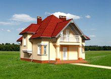 Великолепный особняк с желтыми стенами под красной крышей