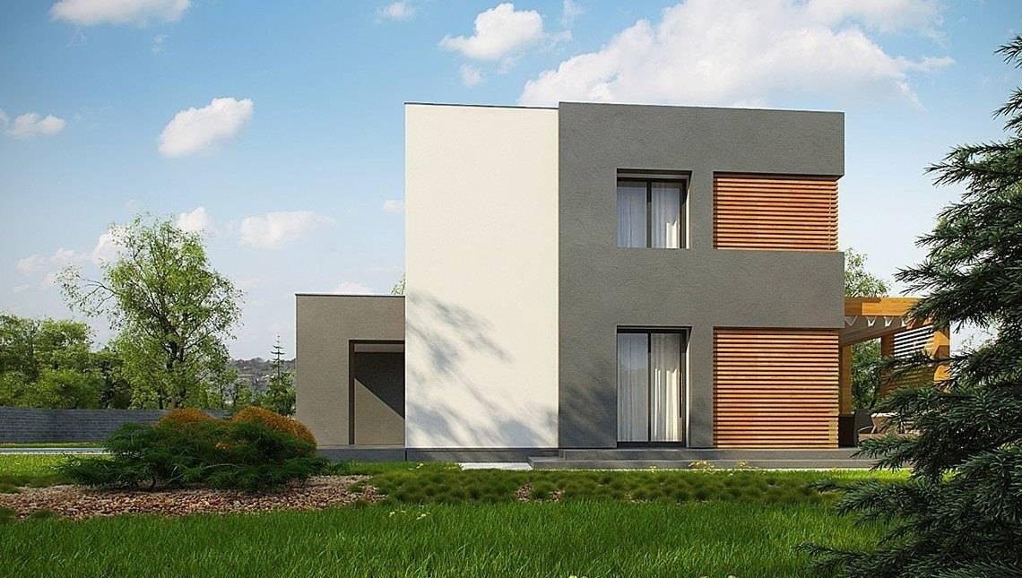 Небольшой двухэтажный дом с плоской кровлей