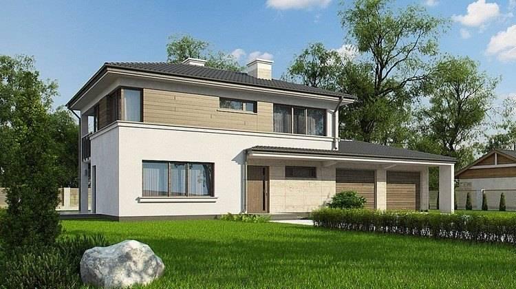Современный двухэтажный дом с гаражом в пристройке
