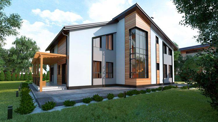 Современный двухэтажный особняк с панорамными окнами