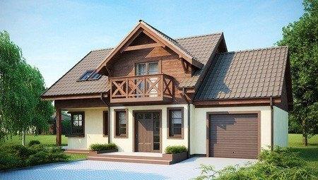 Проект коттеджа с гаражом, красивой мансардой и боковой террасой