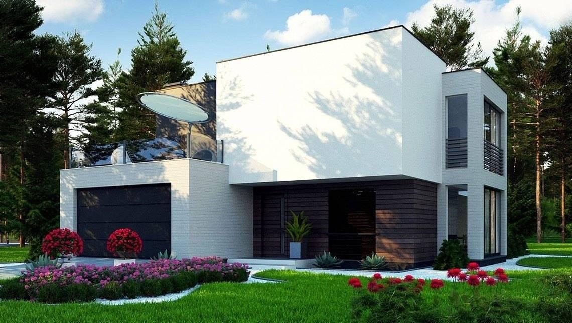 Небольшой современный двухэтажный дом с террасой на втором этаже