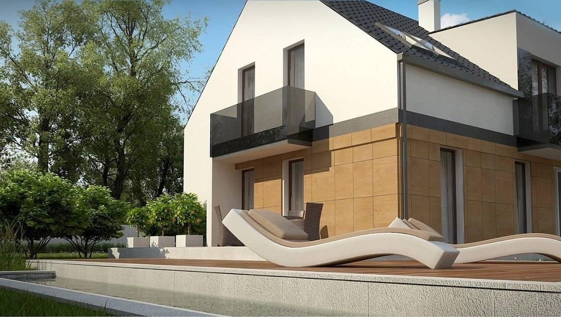Двухэтажный дом в классическом стиле с эклектическим включением кубизма
