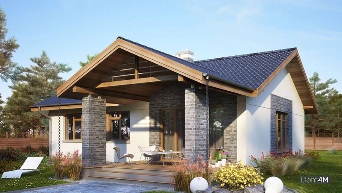 Одноэтажный стильный коттедж с камином в центре дома